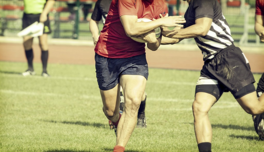 Rugby players fighting for ball