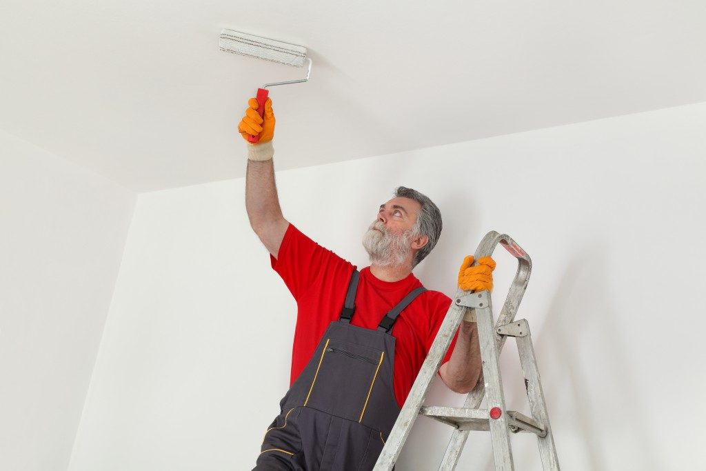 Man painting the ceiling